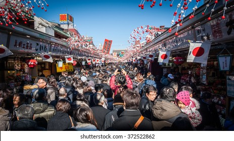 Senso-ji Temple, Tokyo - January 03 2015:  Thousands make their annual New Year visit to one of Japan's most famous temples.