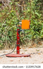 A sensor on the finishing line of a rally competition measuring arrival times