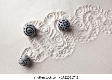 Sensory sand game. Modern zen garden concept. Top view