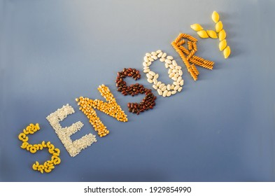 Sensory word written of rice, popcorn, beans, pasta. Sensory play for child at home. Activities Montessori, games for sensory processing disorder, child development and occupational therapy