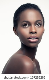 Sensual African woman against a white background.