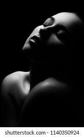 sensual aroused woman with closed eyes on black background monochrome
