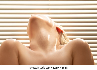 sensual aroused woman in sun light with blinds