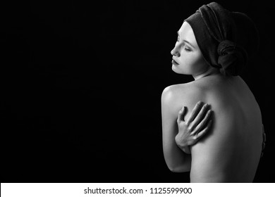 sensual aroused young woman with closed eyes on black background with copy space, monochrome