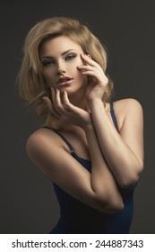 Sensual beautiful blonde woman posing in sensual lingerie. Girl with long curly hair.