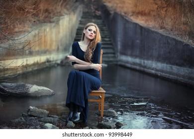 sensual beautiful girl sitting on chair on ice