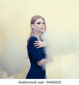 sensual beautiful girl in white smoke on nature