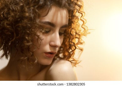 sensual beautiful serious young woman standing, closeup portrait, side view, looking aside