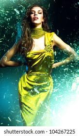 sensual beautiful woman in green dress and broken glass