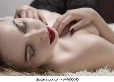 sensual beautiful woman in stockings lying in bed