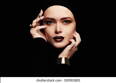 sensual beautiful woman,jewelry ring.female face like a mask. girl with make-up,purple lips.fashion portrait