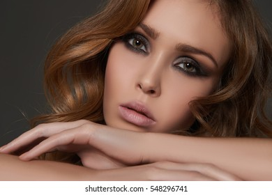 sensual beauty girl with make-up and curly hairstyle. Beautiful woman fashion portrait, smokey eyes