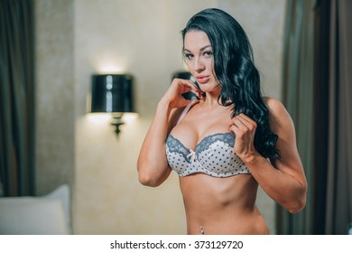 Sensual blonde beautiful woman posing in lingerie  bedroom. Girl fitness model.