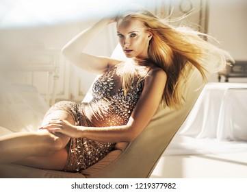 Sensual blonde beauty posing