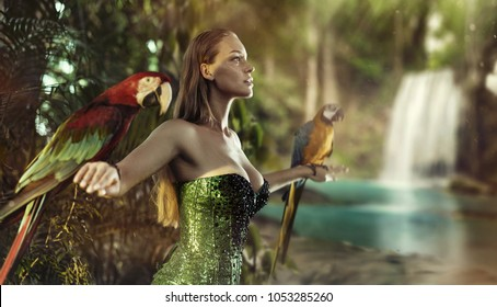 Sensual blonde beauty posing with parrots in the jungle