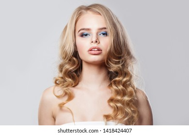 Sensual blonde woman on white background, fashion portrait