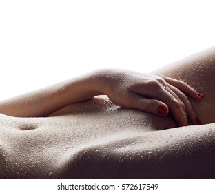 Sensual body of young woman with drops of water isolated on white background