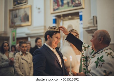 Sensual bride and groom at wedding ceremony in crowns