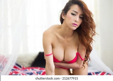 Sensual brunette asian woman in lingerie.