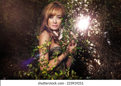 Sensual brunette lady posing outdoor in autumn scenery. Girl looking at camera.