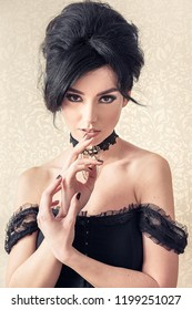 Sensual brunette model retro styled with powerful look and elegant hands on the face. Sophia Loren lookalike concept