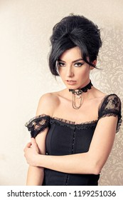 Sensual brunette model retro styled with jewelry choker looking straight on white floral background. Sophia Loren lookalike concept