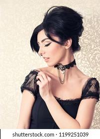 Sensual brunette model retro styled looking aside at her shoulder on white floral background. Sophia Loren lookalike concept