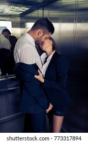 sensual business couple undressing in elevator