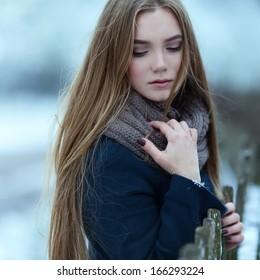 Sensual closeup portrait of beautiful girl in winter