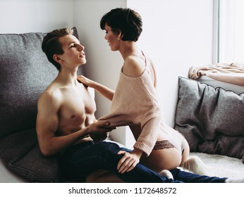 Sensual couple, girl in panties. Man touching woman close up.
