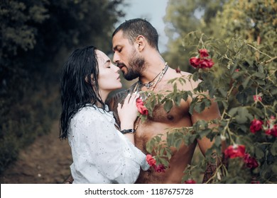 Sensual couple kiss. First love. Hugs together and sensual touch. Intimate relationship and sexual relations. Passionate lover caressing arousing beautiful woman. Woman with muscular latin lover