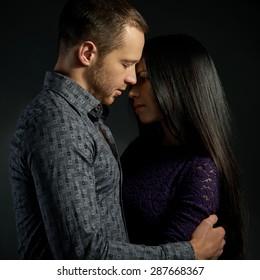 sensual couple in love on dark background