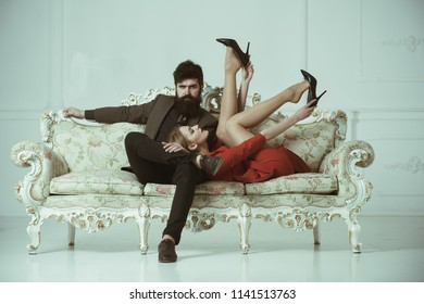 sensual couple on sofa. sensual woman and bearded man relax. sensual girl with her man. sensual and beautiful