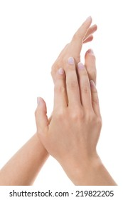 Sensual female hands isolated on white with a woman with neat manicured natural nails gracefully holding her wrist as she raises her hands