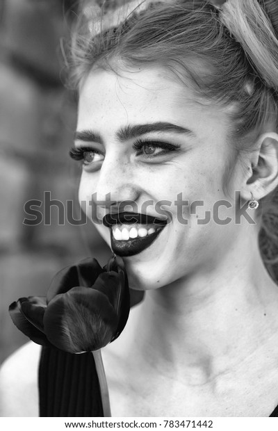 Sensual girl with fresh beautiful red poppy seed flower outdoor in spring