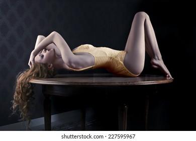 Sensual girl lying in the shadows