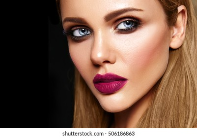 sensual glamour portrait of beautiful woman model with fresh daily makeup with dark pink lips color and clean healthy skin face