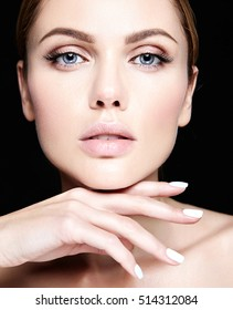 sensual glamour portrait of beautiful woman model with no makeup and clean healthy skin on black background