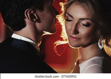 Sensual groom kissing beautiful bride, face closeup