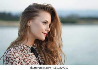 sensual and happy woman face by the sunset