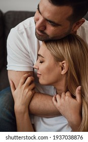 Sensual indoor portrait of a young married couple. Man and woman. Romantic relationship
