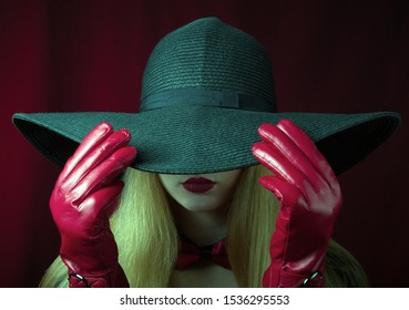 Sensual lady with a hat. Red gloves.The concept of seduction.