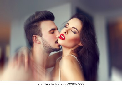 Sensual lovers foreplay indoor. Hot milf with young macho lover