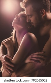 sensual lovers hugging, on brown with back light
