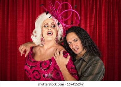 Sensual man in drag with handsome boyfriend