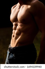 Sensual mans body, abc. Torso with six packs looks attractive on black background. Handsome man muscular topless body. Torso six packs attractive. Strong man with torso. Sexy muscular man.