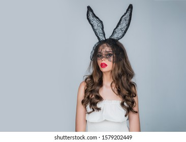 Sensual model girl in bunny ears. Portrait of beauty model girl with bright smokey make up. Sensual model girl with smooth skin and makeup. Young beautiful girl. Portrait desire woman. Valentines day
