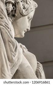 Sensual neoclassic woman marble statue in Burggarten park in Vienna, Austria