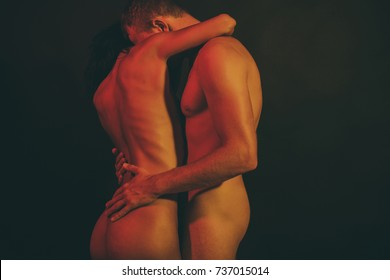 Sensual. Passionate couple. Fashion studio photo of beautiful sexy couple. Gorgeous woman with hair posing with handsome man. Nude man and woman. Sexy photo. Nude pictures. Sexual. Sexuality. Nude