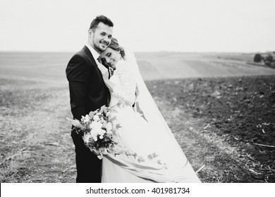 Sensual photo of the groom and bride